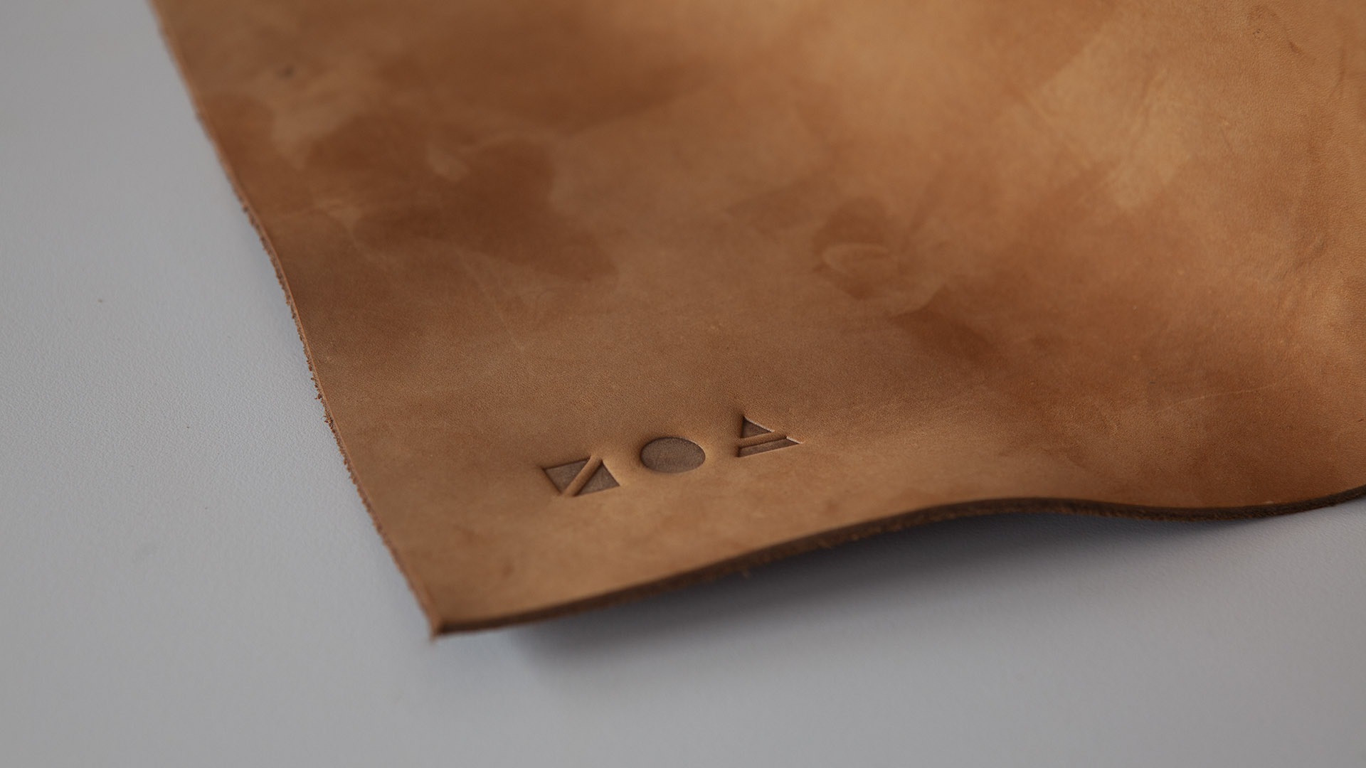 Zoa logo embossed on leather