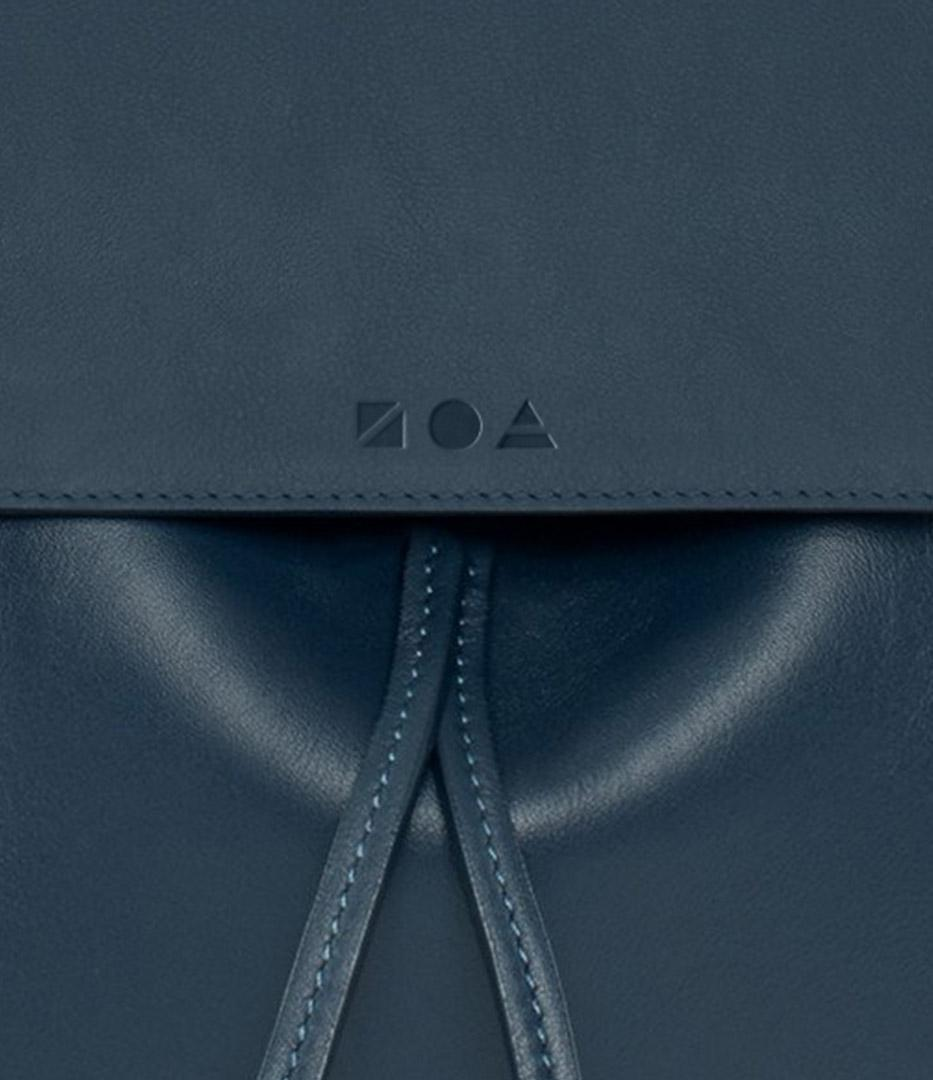 Zoa logo embossed on leather purse